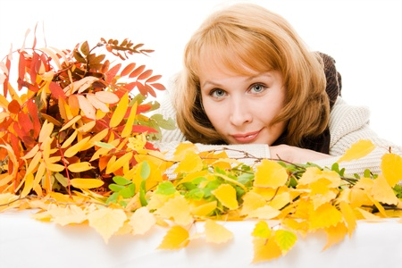 Woman in autumn foliage on a white background. photo