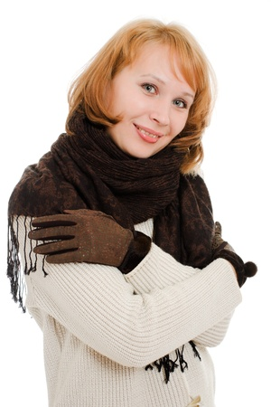 The woman is cold on a white background. photo