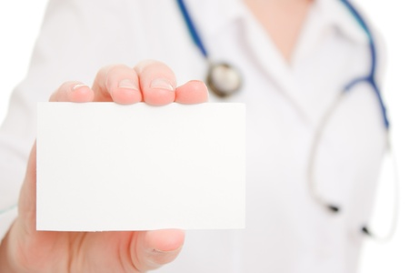 Doctor holding blank card on white background. photo