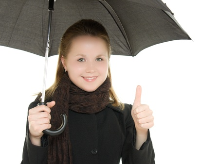 The woman is well under an umbrella on a white background. photo