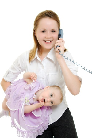 Businesswoman with a baby in her arms on the phone. photo