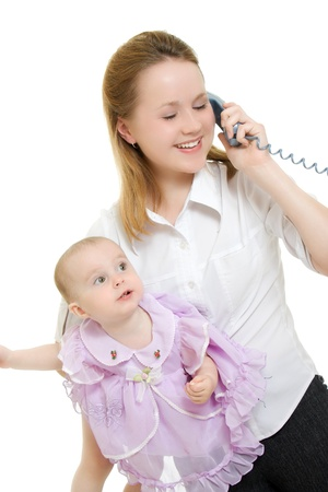 Businesswoman with a baby in her arms on the phone. Stock Photo - 11325349