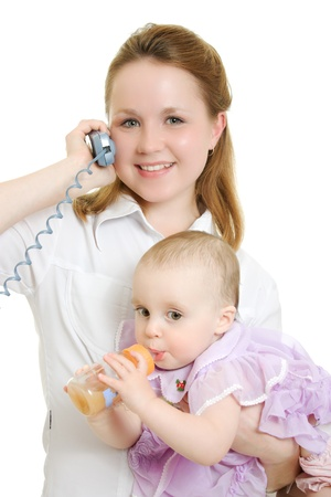 Businesswoman with a baby in her arms on the phone. Stock Photo - 11325352