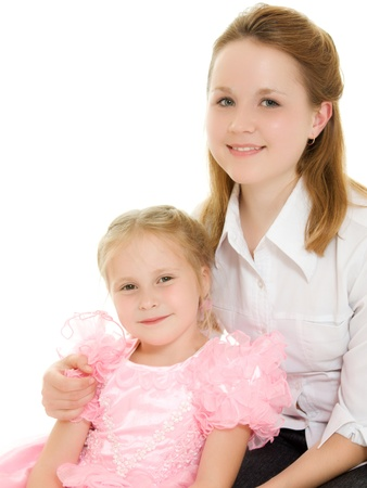 A woman hugging a girl on a white background. photo