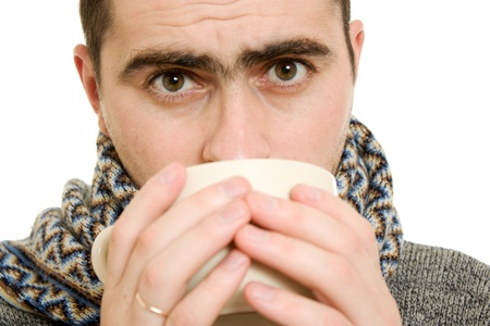 A patient man with a cup on a white background. photo