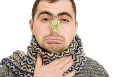 A patient man with a stuffy nose on a white background. photo