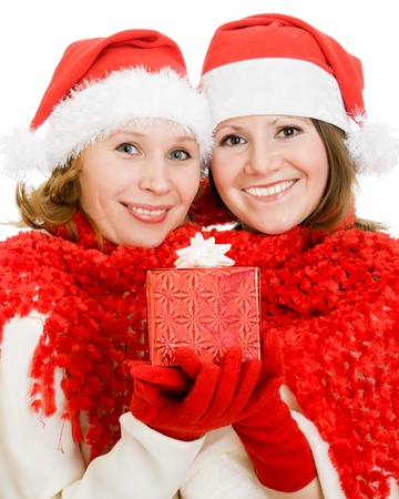 Two woman with Christmas presents on a white background. photo