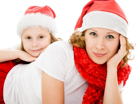 Happy Christmas mother and daughter on a white background. photo