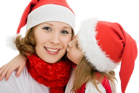 Happy Christmas baby kissing mother on a white background. photo
