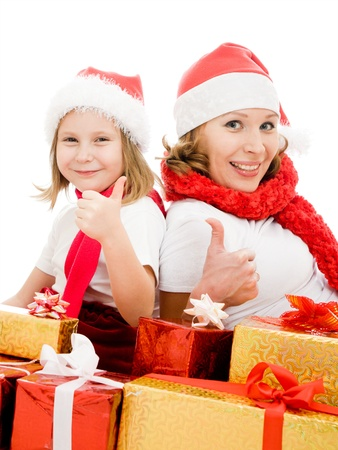 Happy Christmas mother and daughter with presents on a white background. photo