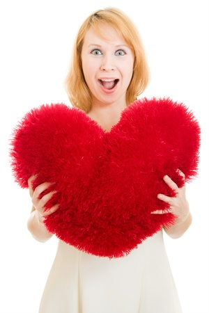 Surprised girl with a heart on a white background. photo