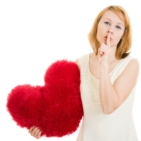 The girl with the heart gesture shows the silence on white background. photo
