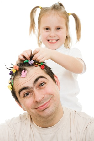cornrows: Daughter of braids cornrows his father on a white background.