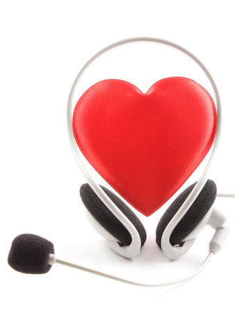 Heart headphones and a microphone on a white background. photo