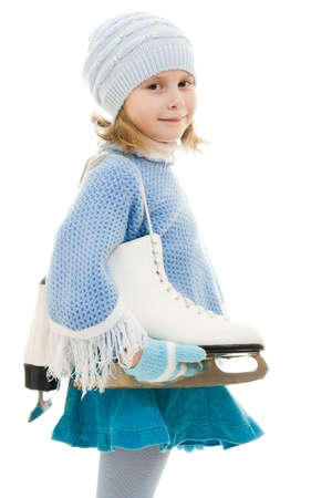 A girl with skates on white background. Imagens