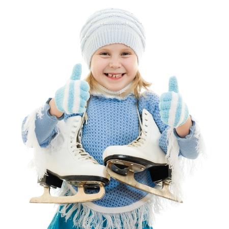 patinaje sobre hielo: Una chica con patines sobre fondo blanco. Foto de archivo