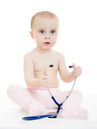 Happy baby with stethoscope on white background. photo