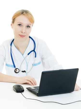 A woman doctor consultant with a laptop on a white background. photo