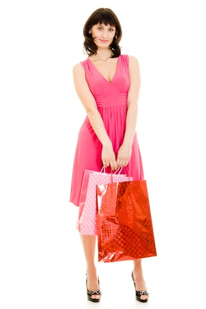 Girl with shopping in the red dress on white background. Stock Photo - 11901772