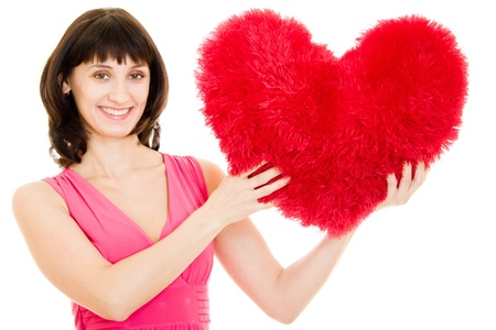 A woman holds a heart in his hands on a white background. photo