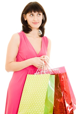 shoppingbags: Girl with shopping in the red dress on white background.