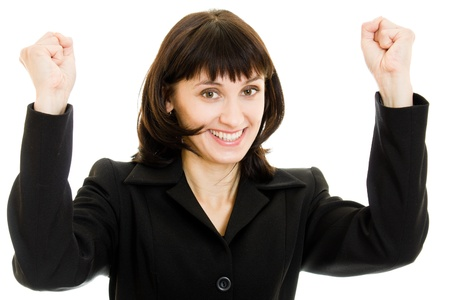 Portrait of happy business woman cheering her success on white background photo