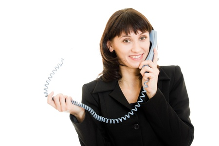 Beautiful smiling business woman talking on the phone Stock Photo - 11901828