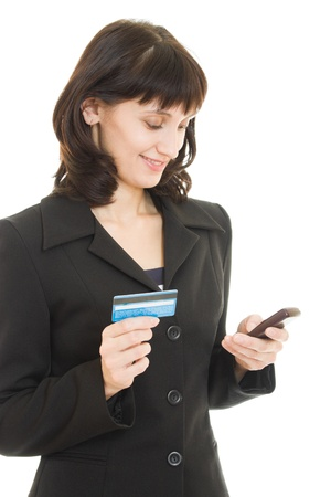 business woman paying with credit card by cellphone, on white background. Archivio Fotografico