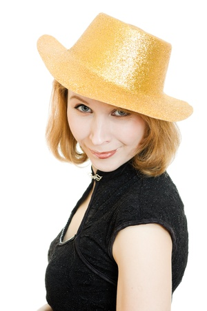 beautiful woman in a gold hat on a white background. photo