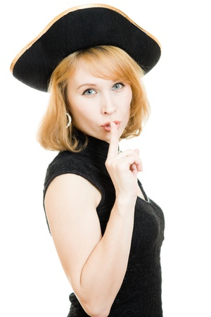 A beautiful woman in a black pirate hat on a white background. photo