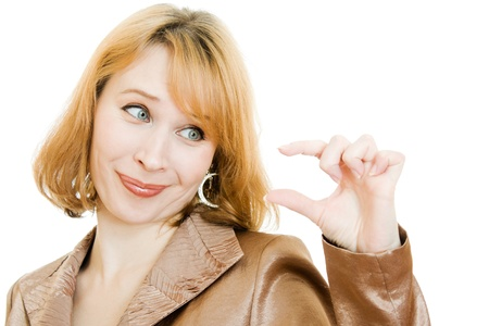 selling points: A woman looks at a small object in his hand on a white background. Stock Photo