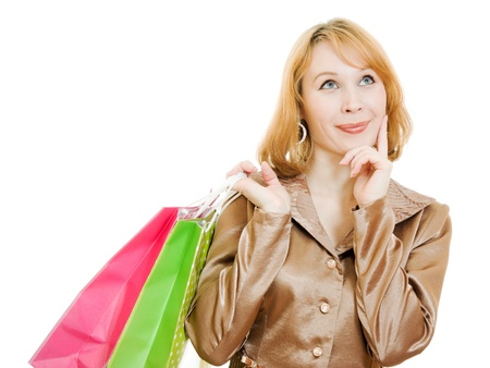 A beautiful woman in a gold suit with a shopping dreams on a white background. photo