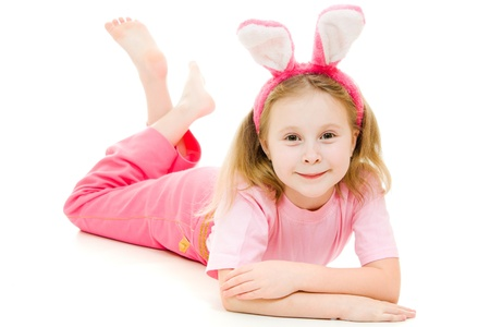 The little girl with pink ears bunny on white background. photo