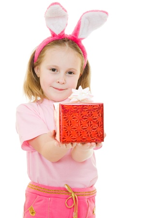 The little girl with pink ears bunny with a gift on a white background. photo