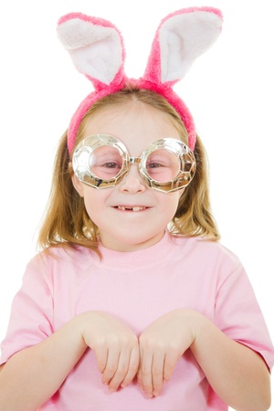 The little girl with pink ears and a rabbit wearing glasses on white background. photo