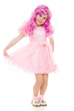 modest: A girl with pink hair in a pink dress on a white background.