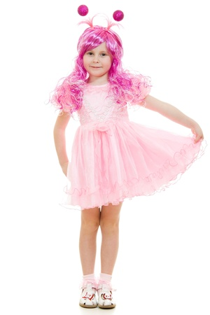 A girl with pink hair in a pink dress on a white background. photo