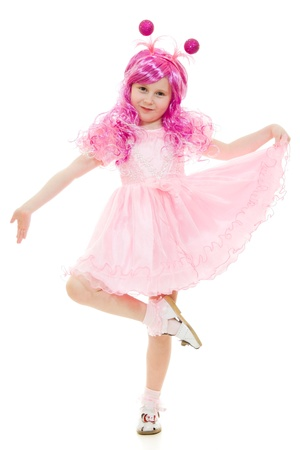 A girl with pink hair in a pink dress dancing on a white background.