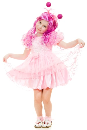 A girl with pink hair in a pink dress dancing on a white background. photo