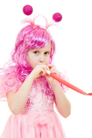 A girl with pink hair in a pink dress blowing a whistle on a white background. Stock Photo - 12035333