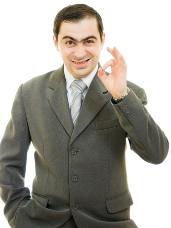 A successful businessman gesture shows okay on a white background. Stock Photo - 12036657