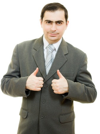 A successful businessman gesture shows okay on a white background. photo