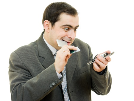 businessman changed the battery in the phone on a white background. photo