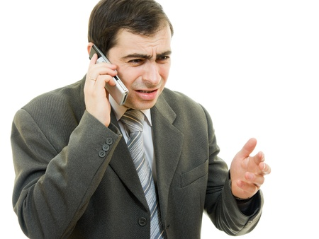 Businessman in distress speaks by phone on a white background photo