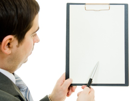 A businessman with a white blank sheet of paper on a white background. photo