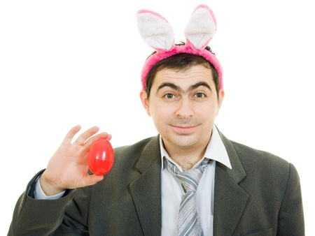 Businessman with rabbit ears on a white background. photo