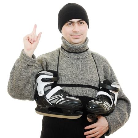 Men with skates points his finger on white background. Stock Photo - 12388203