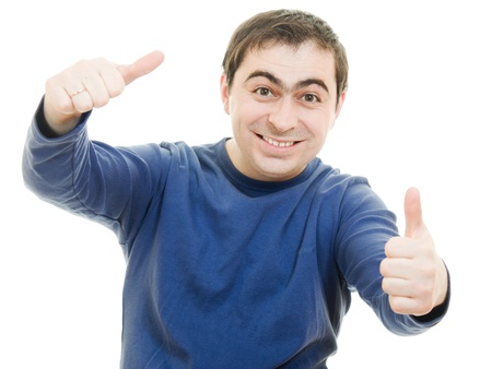 A successful man shows gesture okay on a white background. photo