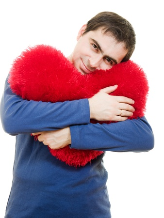 A man holding a big red heart on a white background. photo