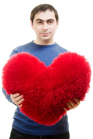 A man holding a big red heart on a white background. Stock Photo - 12388109